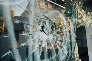 broken window, looted store, looting, protest damage, business damaged in protest, business damaged by looting,