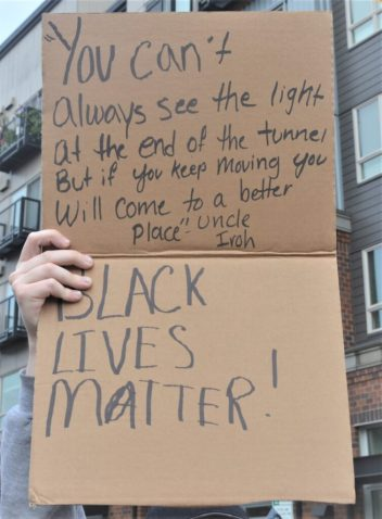 A protester holds a sign during the June 2 BLM protest | photo by Amy Thompson