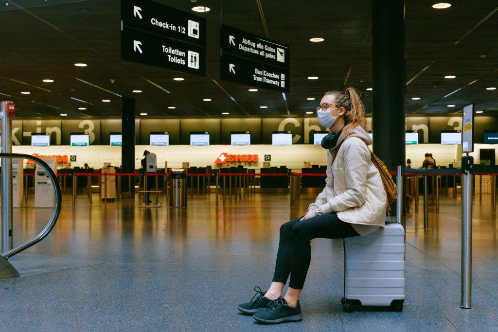 covid-19, covid-19 traveler, masked traveler, airport, covid-19 airport, international travel, quarantine, travel quarantine,