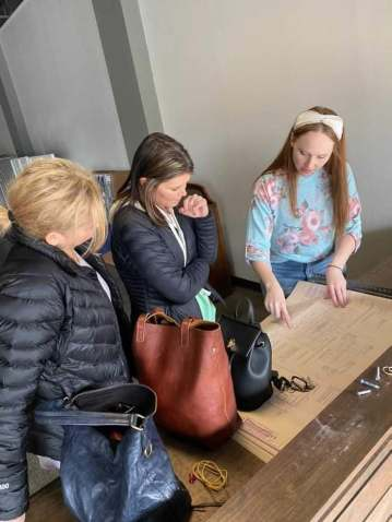 Classic Farmhouse owner Katy Selden and her team review store floor plans at the new Main Street store