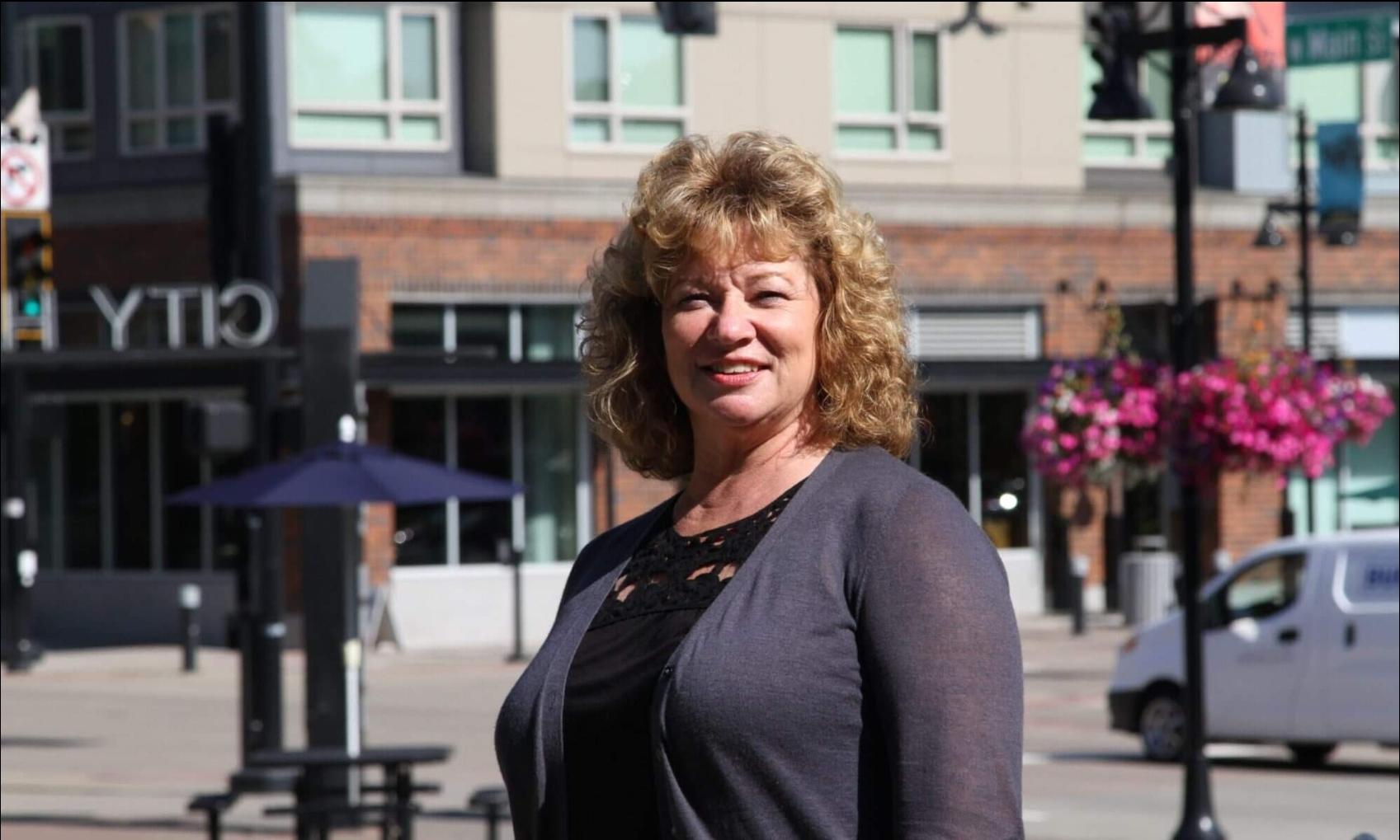 Auburn Mayor Nancy Backus stands in downtown Auburn on a sunny day