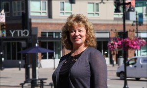 Auburn Mayor Nancy Backus stands in downtown Auburn on a sunny day