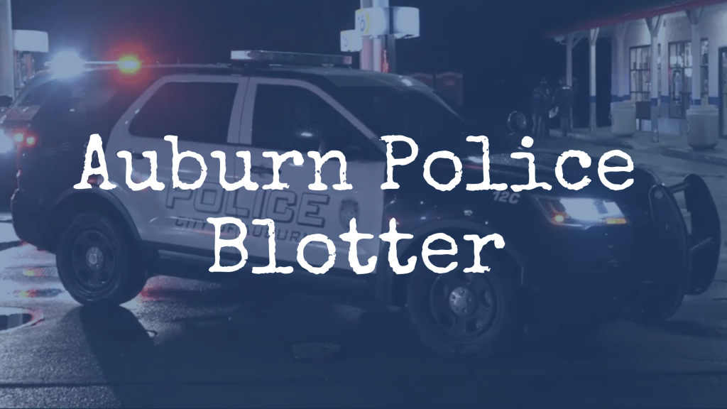 "a photo of an APD SUV at night at a crime scene at a gas station ""Auburn Police Blotter"" is written over the photo"