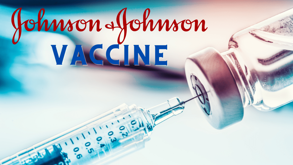 "A needle pulls from a small vaccine bottle. ""Johnson & Johnson Vaccine"" is written on the blue toned photo"