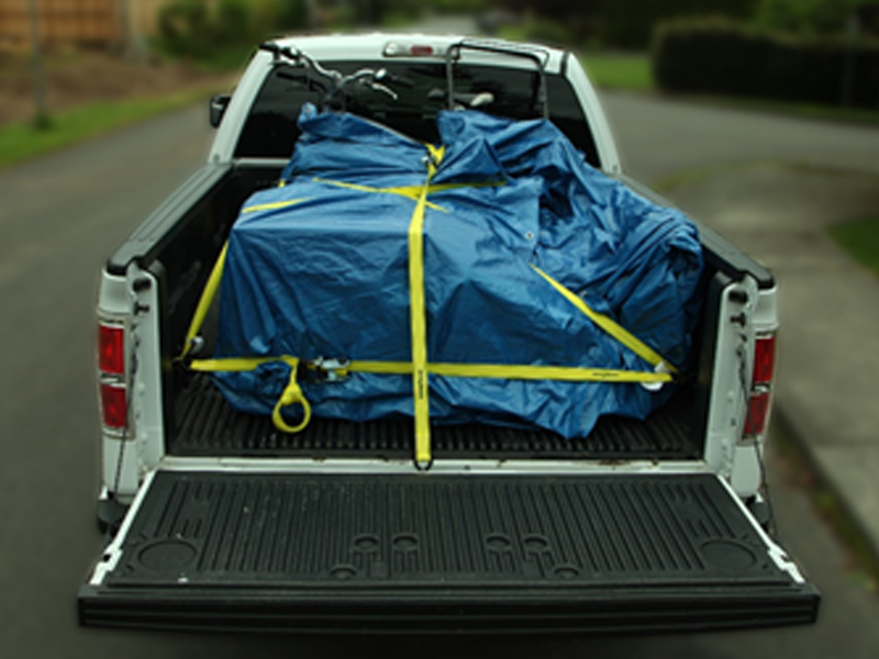 a truck with a secured load in its bed