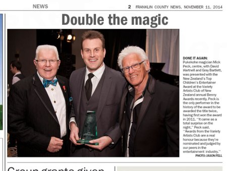 Auckland magician Mick Peck wins the 2014 Variety Artists Club Top Children's Entertainer Award. Pictured with VAC Patrons David Hartnell and Gray Bartlett.