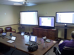 The Purple Wave auction situation room with on...