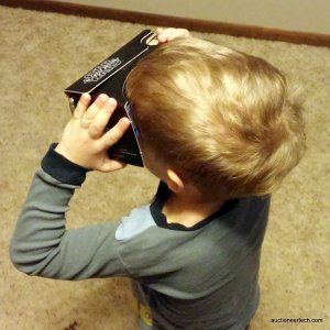 Nolan playing with Verizon's Star Wars Cardboard viewer