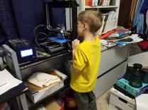 Nolan watches the 3D printer