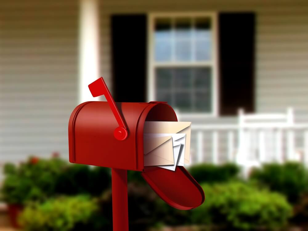 open red mailbox with letters inside