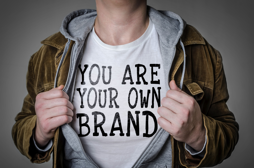 man with open jacket - tshirt reads you are your own brand