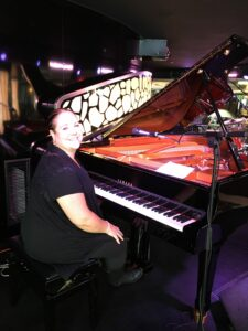 Michele McLaughlin at the piano onboard the MSC Divina