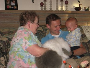 Great Grandma McConkie making Cooper giggle with a giant dog puppet. How funny that she's wearing the same shirt in this picture.