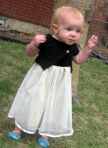 An old sweater shirt into an asymmetrical cardigan and an old dress into a special occasion toddler dress.