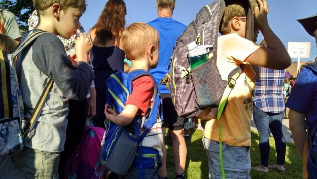 Waiting in line with his class.
