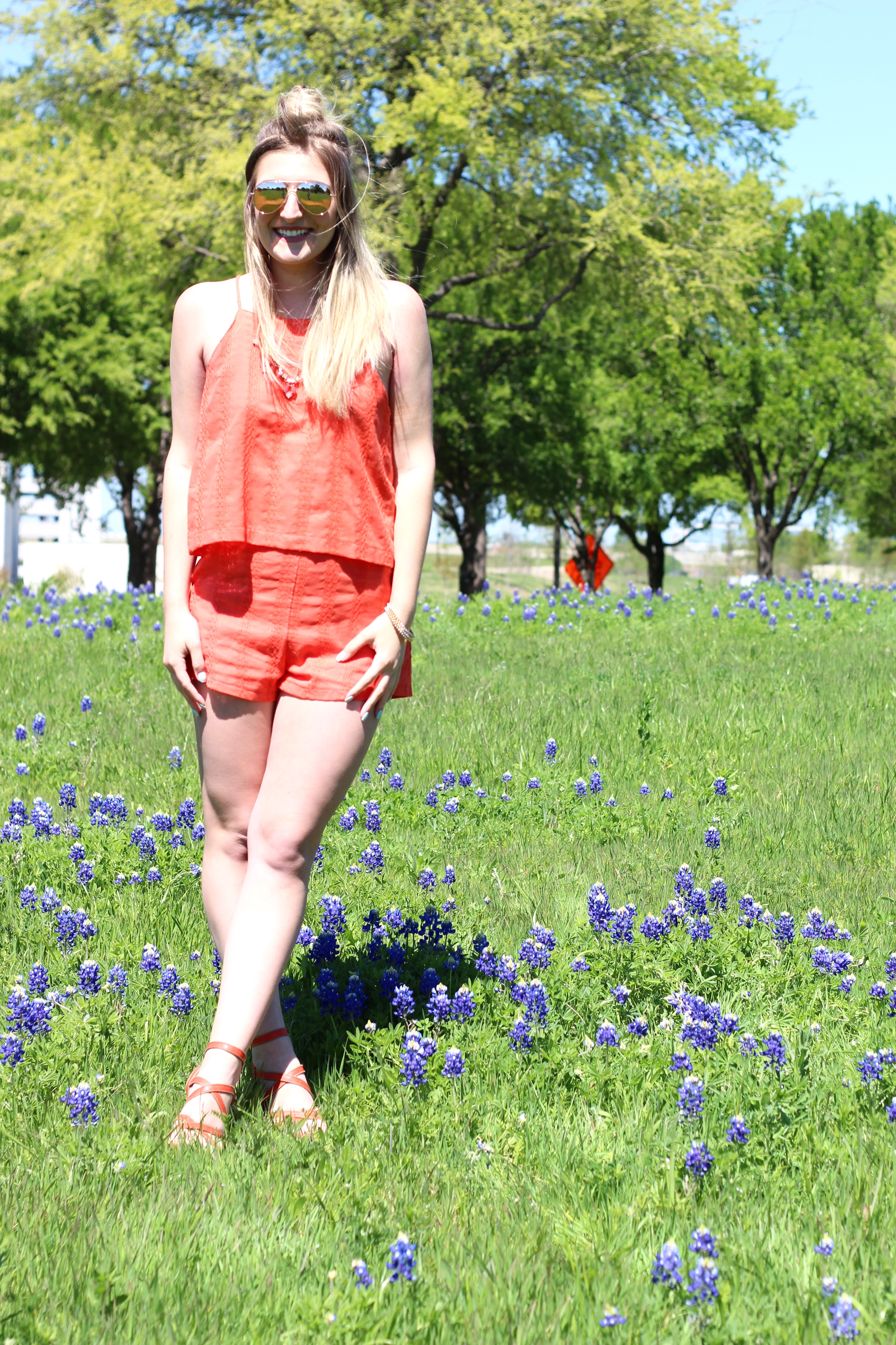 blue bonnets in texas in an orange outfit