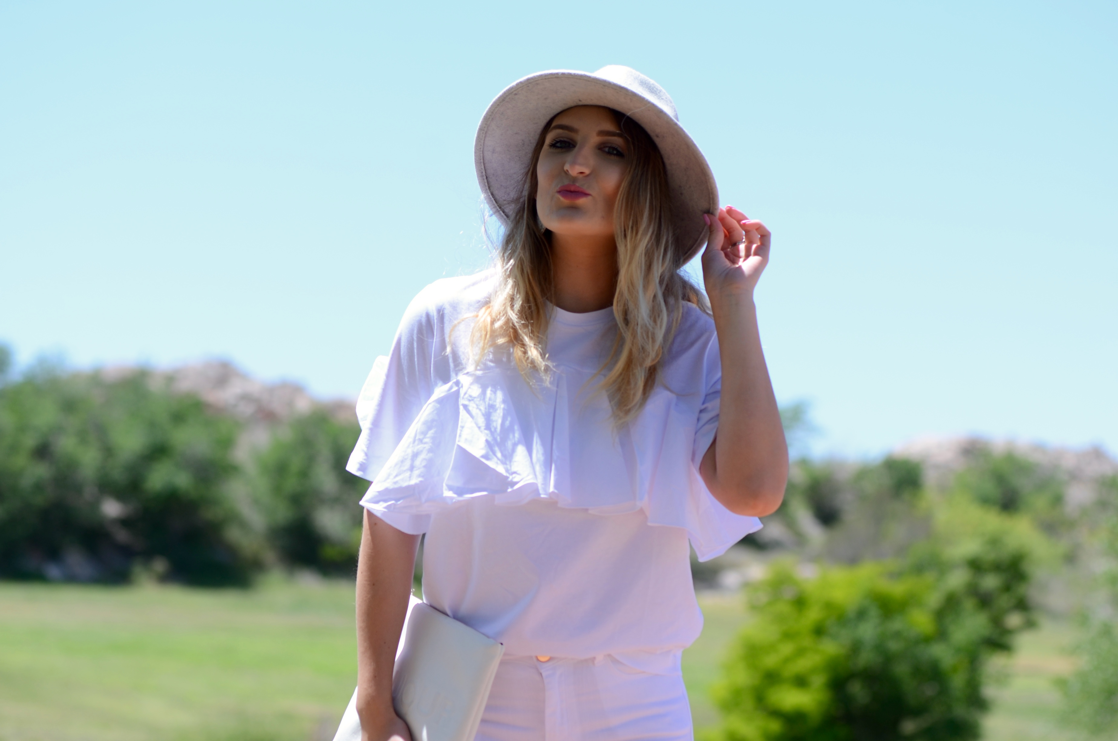 white ruffled top look
