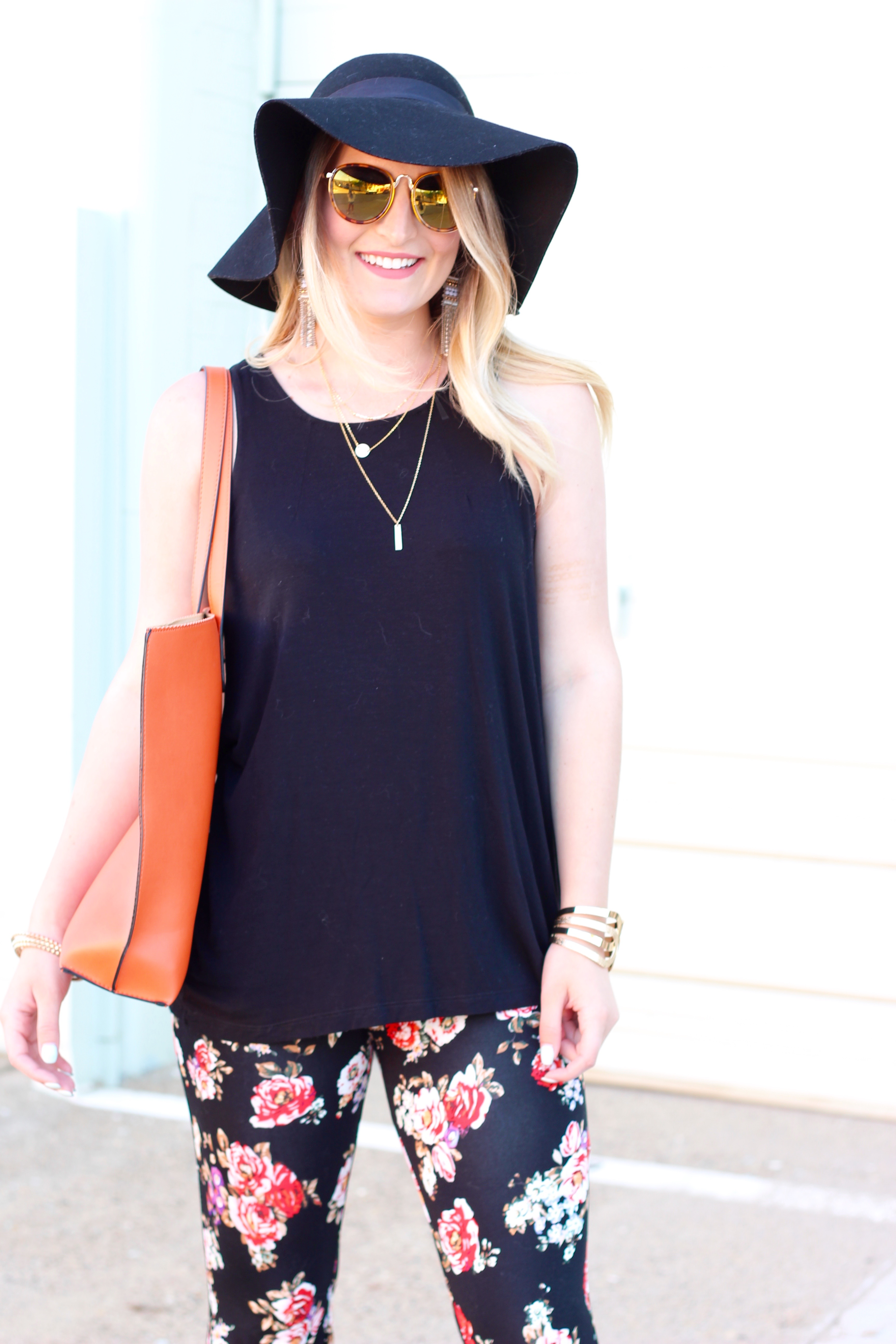 orange bag and floral pants for summer