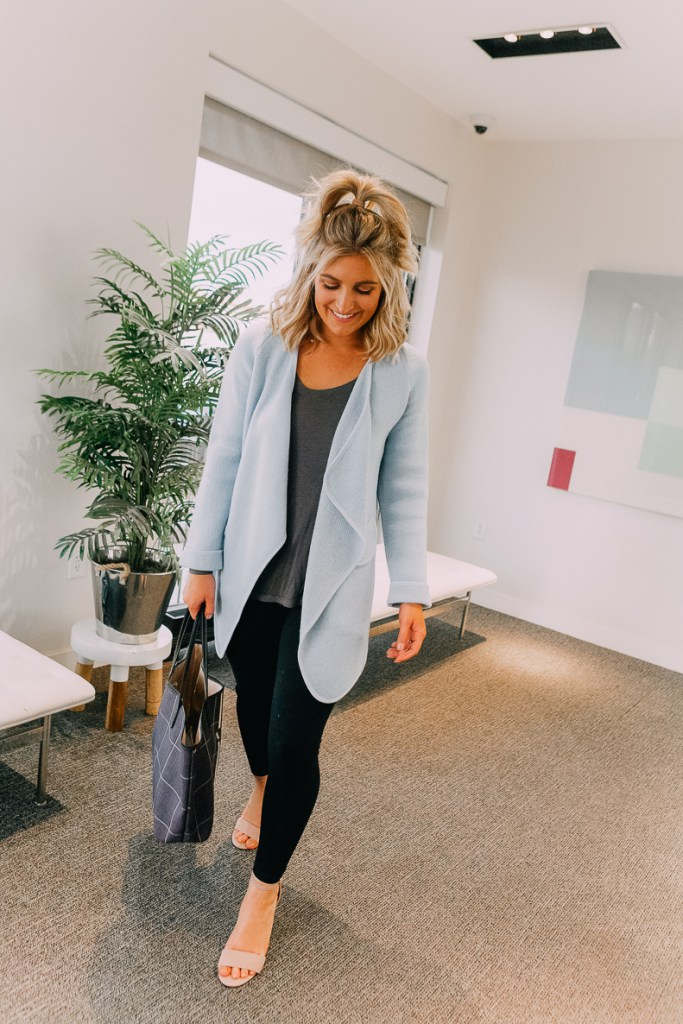 How To Style Leggings For Work featured by top US fashion blogger Audrey Madison Stowe; Image of a woman wearing a Free People top and Chicwish cardigan/coat.