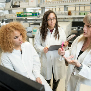 Kathleen Alexander, right, secured a Research Experience for Undergraduates grant from the National Science Foundation to enable Michelle Wright, left, and Madalyn Fox to conduct research in Africa.