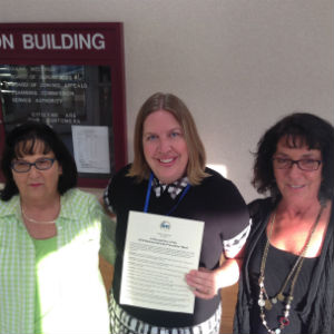 Virginia Graham, Crystal Abbe Graham and Donna Bailey accept the National Suicide Prevention Week proclamation from the Augusta County Board of Supervisors.