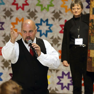 Ben Yoder of Enlisted Auctions running the show during Augusta Health's Hospice of the Shenandoah's Annual Quilts of Comfort Auction.