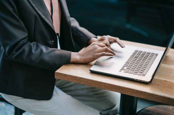 ethnic female remote worker using laptop for business project