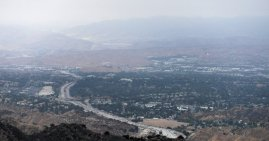Looking north you can see the western half of Santa Clarita. They freeway is I-5 In the distance you can barely make out Castaic Lake and its dam.