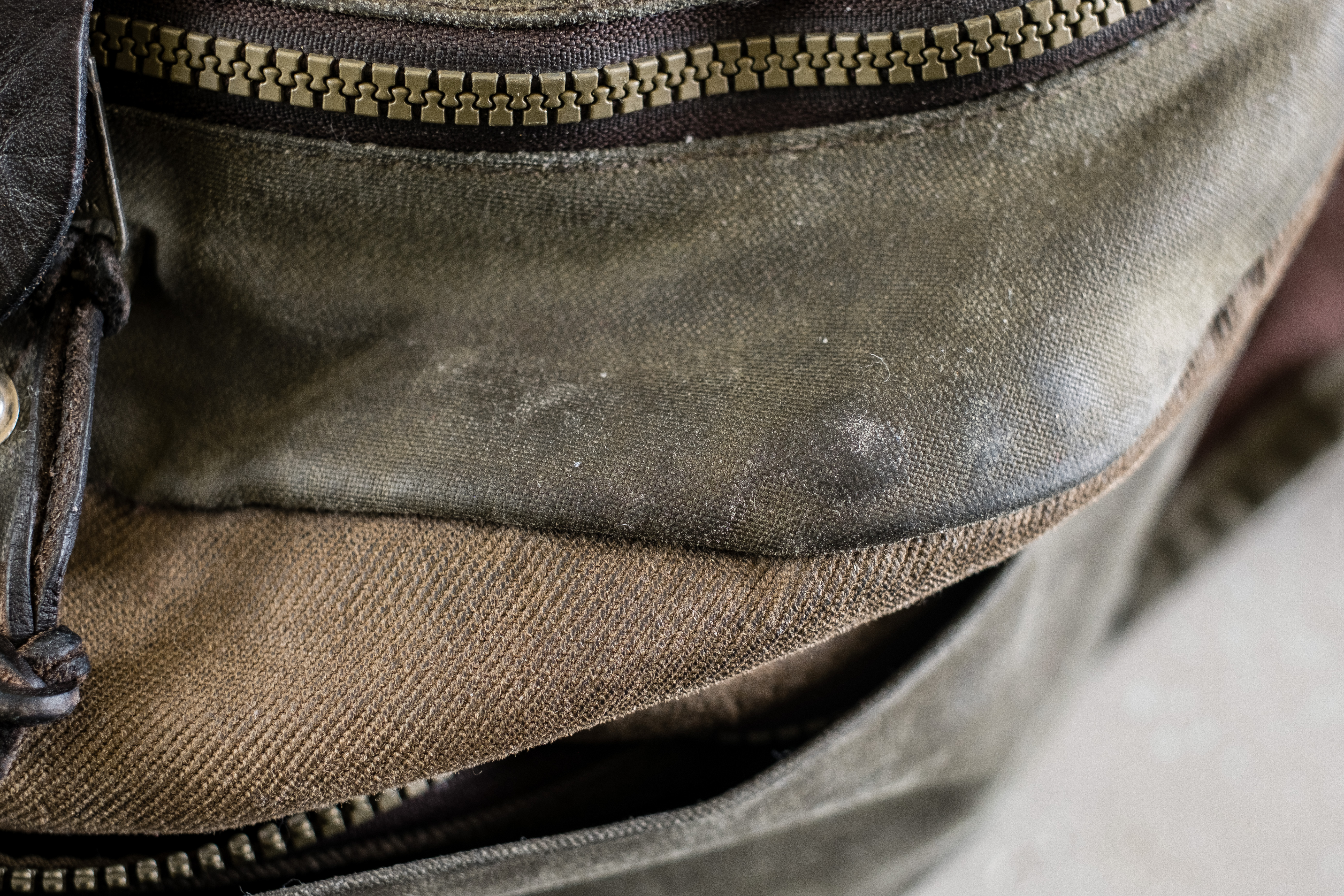 65ade0f673 Filson Photographer s Backpack (same outer design as the Journeyman Backpack)  uses a combination of tin cloth and rugged twill.