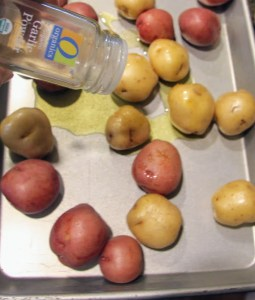seasoning baby potatoes on sheet pan