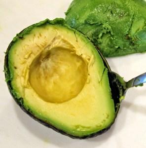 scooping avocado
