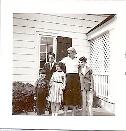 Mother's Day 1955, Three Village Inn, Stony Brook Long Island. Bruce aka BooBoo age 4, Bill at 13, me at 8, Mom was 35, and Rick at 10.