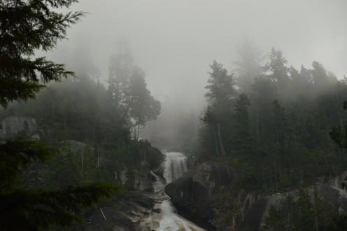 The top of Shannon Falls shrouded in foggy mist.