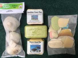 Re-purpose the small nylon bags that contain ginger or garlic. Place soap shards in them, then stitch it closed.