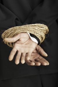 Rope wrapped around hands.