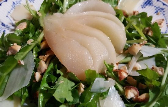 Poached pear arugula salad with hazelnut