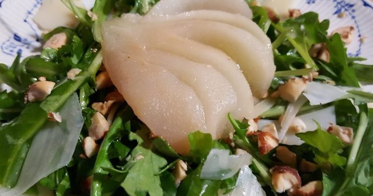 Poached pear arugula salad with hazelnut