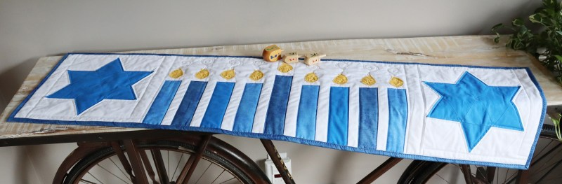 Hanukkah-Menorah-Table-Runner-full-view-on-table