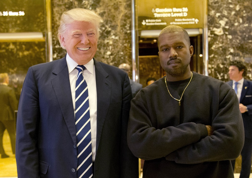 FILE - In this Dec. 13, 2016, file photo, President-elect Donald Trump and Kanye West pose for a picture in the lobby of Trump Tower in New York. Kanye West will visit the White House on Thursday to meet with President Donald Trump and his son-in-law Jared Kushner talk about manufacturing in America, gang violence, prison reform and Chicago violence. (AP Photo/Seth Wenig, File)