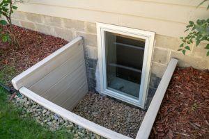 basement remodeling project egress window installation