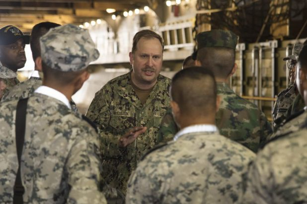 LAEM CHABANG, Thailand (Feb. 12, 2018) Capt. Larry McCullen, middle, commanding officer of the amphibious assault ship USS Bonhomme Richard (LHD 6), discusses the ships well deck capabilities to officers of the Royal Thai military during a ship tour in support of Cobra Gold 2018. (U.S. Navy photo by Mass Communication Specialist 2nd Class William Sykes/Released)