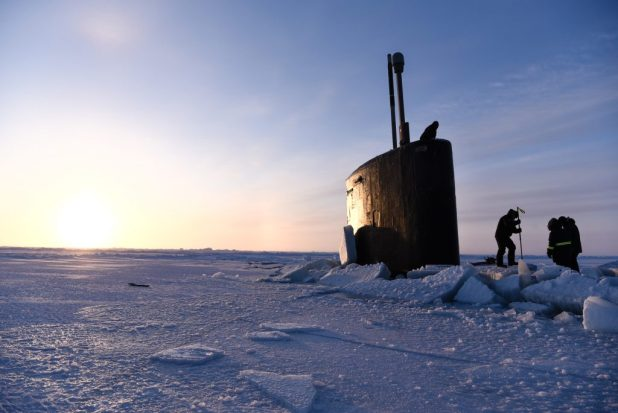 BEAUFORT SEA (March 11, 2018) A field team from Ice Camp Skate prepares to attach a brow aboard the Los Angeles-class fast-attack submarine USS Hartford (SSN 768) in support of Ice Exercise (ICEX) 2018. (U.S. Navy photo by Mass Communication 2nd Class Michael H. Lee/Released)