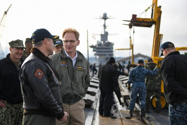 BREMERTON, Wash. (Feb. 15, 2018) Under Secretary of the Navy, the honorable Thomas B. Modly, discusses flight deck operations with Cmdr. Pavao Huldisch, air boss onboard the aircraft carrier USS John C. Stennis (CVN 74) on the ship's flight deck. Modly was aboard for a tour of the ship and to talk to Sailors and command leadership. John C. Stennis was in port conducting routine training as it continues preparing for its next scheduled deployment. (U.S. Navy photo by Mass Communication Specialist 3rd Class Cole C. Pielop/Released)