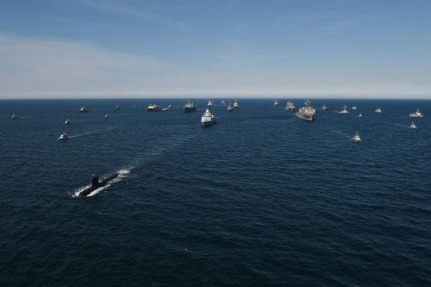 BALTIC SEA (June 9, 2018) Thirty maritime unit ships from 12 nations maneuver in close formation for a photo exercise during Exercise Baltic Operations (BALTOPS) 2018 in the Baltic Sea. (U.S. Navy photo by Mass Communication Specialist 1st Class Justin Stumberg/Released)