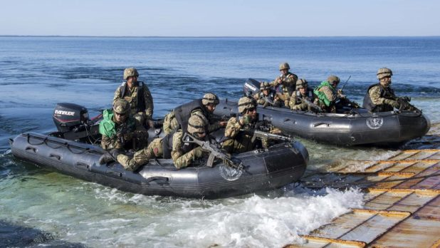 BALTIC SEA (June 10, 2018) Members of the Romanian 307th Naval Infantry Regiment exit the well deck of the Harpers Ferry- class dock landing ship USS Oak Hill (LSD 51) in combat rubber raiding craft during a tactical insertion exercise for exercise Baltic Operations (BALTOPS) 2018. (U.S. Navy photo by Mass Communication Specialist 3rd Class Michael H. Lehman/Released)