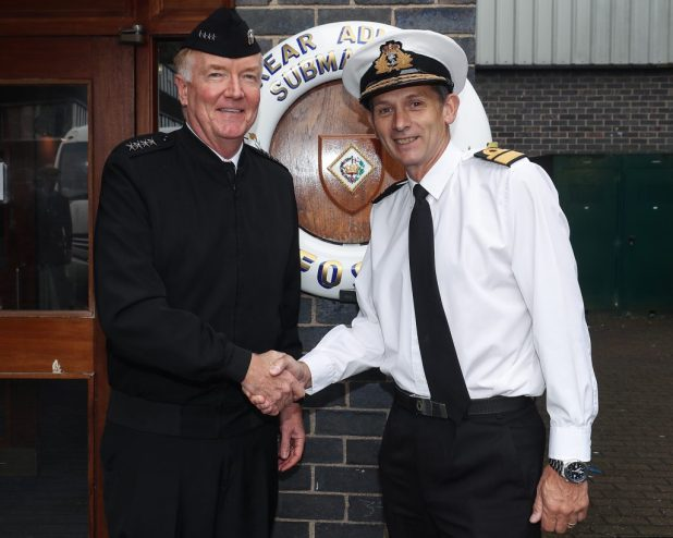 Adm. James G. Foggo III, commander, U.S. Naval Forces Europe-Africa, and commander, Allied Joint Force Command Naples, Italy, left, shakes hands with Royal Navy Rear Adm. John Weale, Flag Officer Scotland and Northern Ireland, Assistant Chief of Naval Staff Submarines and Rear Admiral Submarines, during a visit to Her Majesty's Naval Base (HMNB) Clyde in Faslane, Scotland, Aug. 8, 2018. (Photo courtesy of the Royal Navy/Released)
