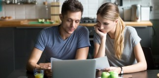 Shutterstock - Couple comparing Internet plans