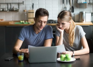 Shutterstock - Couple comparing Internet plans