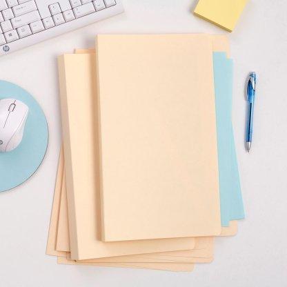 avery dennison corporation buff manilla folders 81502 on desk