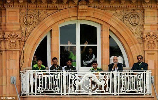 Behind closed doors: Salman Butt (fourth right) watches his team collapse